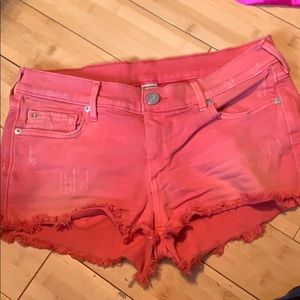 True religion salmon/pink mid rise denim shorts